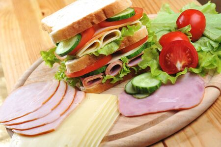 Fresh and tasty sandwich on wooden  table photo