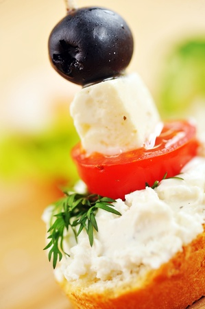 delicious sandwich of toasted bread, tomato and cheese photo