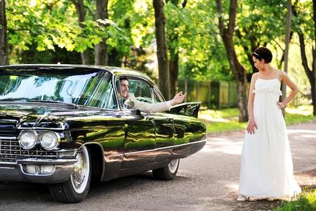 bride  near  car  after their wedding ceremony Stock Photo