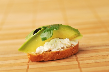 beautiful and delicious sandwich of toasted bread, avocado and spinach photo
