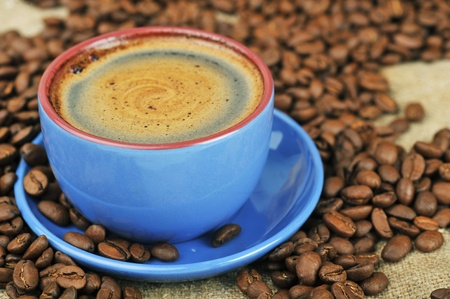 Cup of  coffee and spilled out coffee beans Stock Photo - 9643421