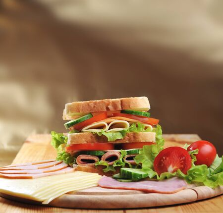 Fresh and tasty sandwich on wooden  table Stock Photo - 9643151