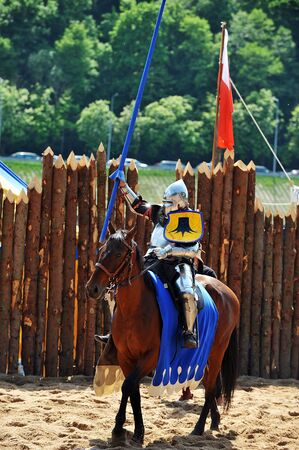 jousting: armored medieval  knight on horseback at jousting competition Stock Photo