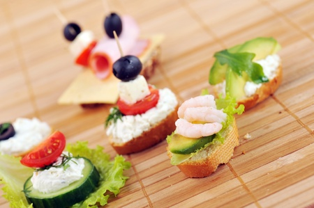 different delicious sandwiches on  bamboo napkin photo