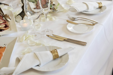 Banquet table setting for wedding dinner photo