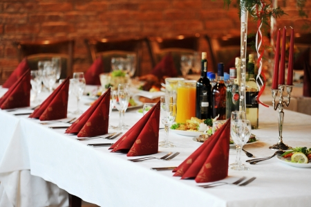 dinner hall: Wedding  reception place ready for guests.  table with food and drink Stock Photo
