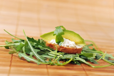 delicious sandwich of toasted bread, avocado and spinach photo