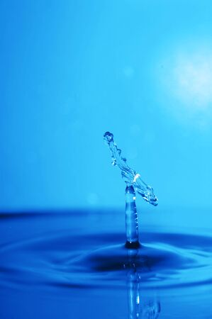blue swirling water splash isolated on blue  background Stock Photo - 10227566