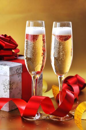 Champagne glasses on  celebratory table photo