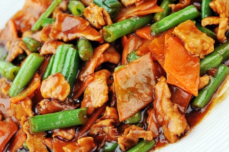 soy sauce:  chinese cuisine. deep fried chicken with red sauce and beans