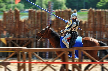 joust: armored medieval  knight on horseback at jousting competition Editorial