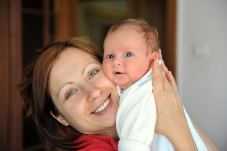 Adorable little baby in arms of his mom. Stock Photo - 10912823