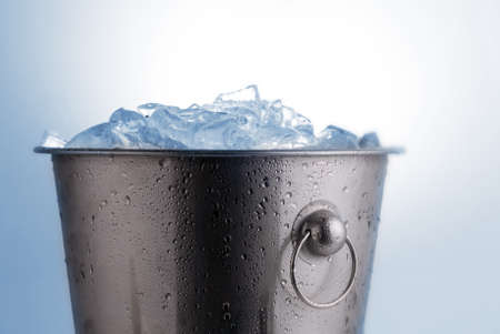 Ice bucket filled with ice cubes photo