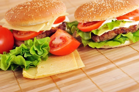 hamburger with cutlet and vegetables on bamboo napkin photo