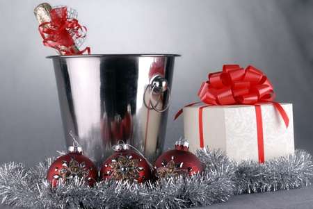 bucket with champagne bottle  and garland. christmas symbols photo