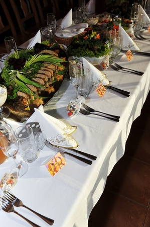 gala reception, places ready for guests. table with food and drink