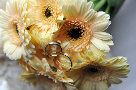 bouquet of yellow flowers  and wedding gold rings photo