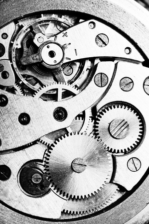 clock gears:  disassembled wrist watch lies on  table Stock Photo