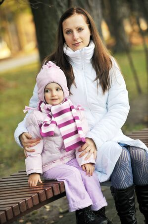 Mother and daughter in autumn  park photo