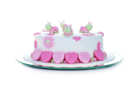 Geburtstagstorte mit weißem Zuckerguss und Marienkäfer