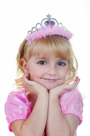 Little girl dressed as princess in pink with tiara