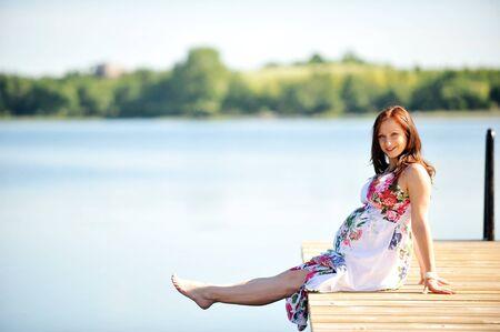 woman sitting  at   jetty. summer Stock Photo - 12393245