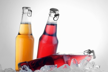 bottles with tasty drink in ice Stock Photo - 12028070