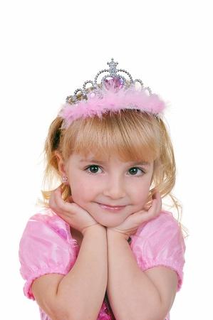 어린 소녀 티아라와 핑크에서 공주처럼 옷을 입고 스톡 콘텐츠