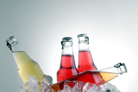 bottle with tasty drink in ice Stock Photo - 12411606