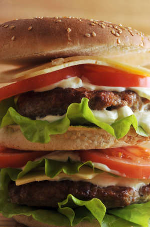 hamburger with cutlet and vegetables close up photo