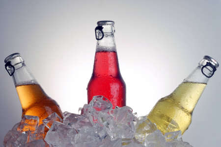 bottles with tasty drink in ice Stock Photo - 12411724