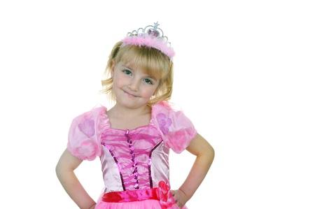 어린 소녀 티에 라와 공주 핑크 옷을 입고 스톡 콘텐츠