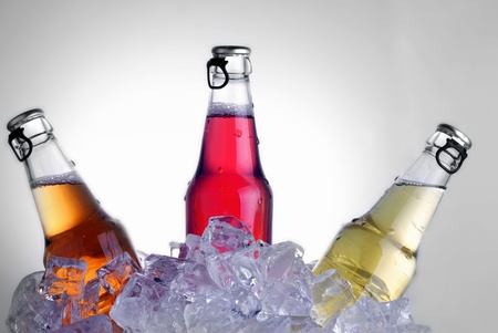 bottles with tasty drink in ice Stock Photo - 13295929