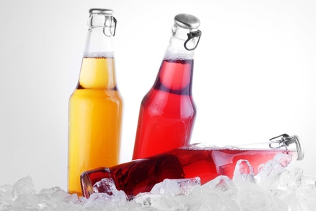bottles with tasty drink in ice Stock Photo - 13497251