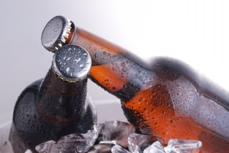 brown bottles of beer chilling on ice photo