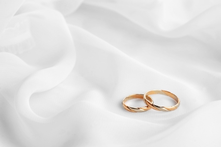 White transparent  fabric and wedding rings close up photo