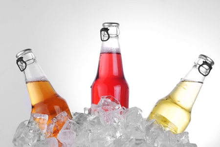 bottles with tasty drink in ice Stock Photo - 14016599