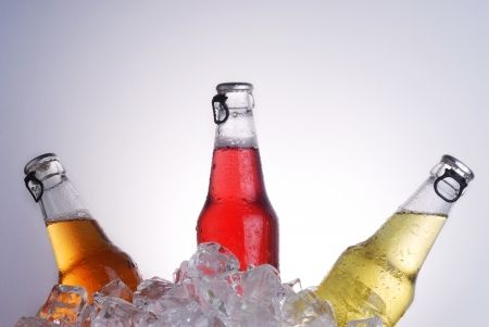 bottles with tasty drink in ice photo