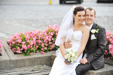 Bride and groom in park  couple on their wedding day photo