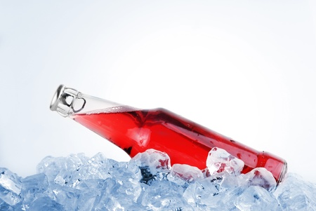 bottle with tasty drink in ice Stock Photo