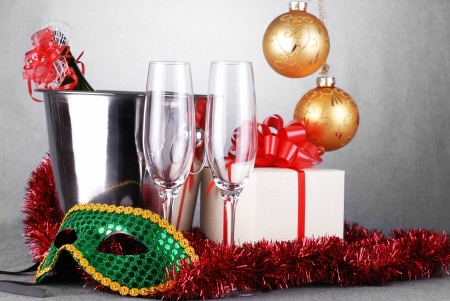bucket with champagne bottle  and green mask. christmas symbols photo