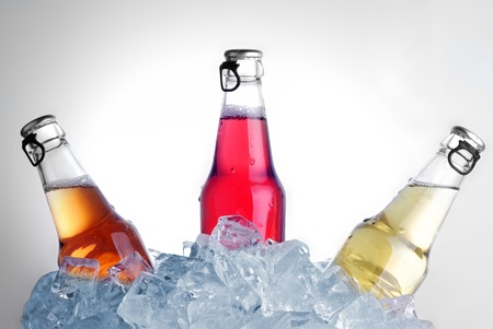 bottles with tasty drink in ice Stock Photo - 14571020
