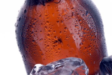 brown beer bottle in ice bucket with condensation  photo