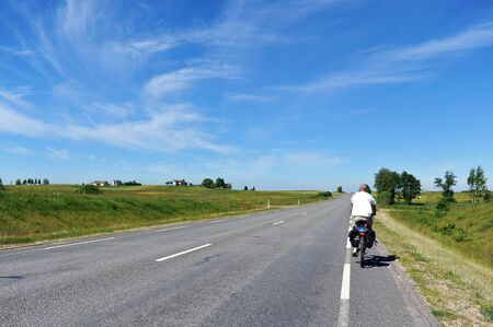 summer day. man riding  bicycle on road Stock Photo - 14864837