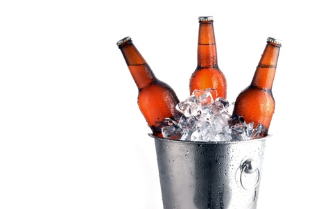 beer bucket: Three brown beer bottles in ice bucket with condensation  Stock Photo