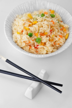 bowl of vegetable fried rice and chopstick. chinese cuisine Stock Photo - 15135450