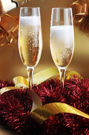 christmas eve: christmas ribbons and two glasses with champagne