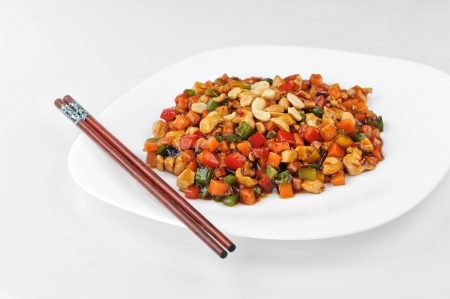 peanut sauce: steamed vegetables and meat with  peanut on plate. Chinese cuisine.