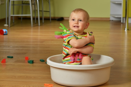 Baby Sitting In A Blue Tub Stock Photo, Picture And Royalty Free ...