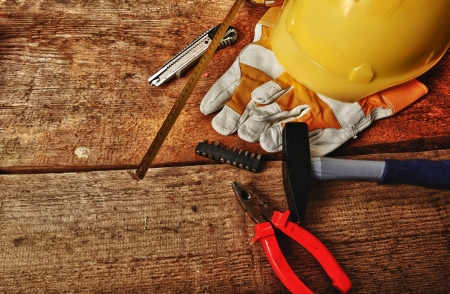 Different tools and gloves on  wooden background. photo